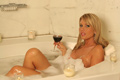 sexy blonde laying in tub in bubble bath