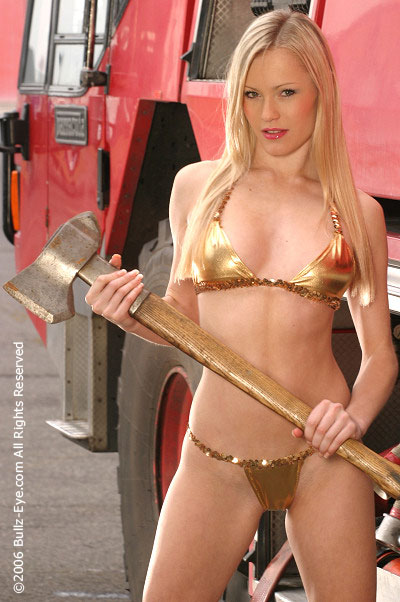 Holly Kishere wields an axe