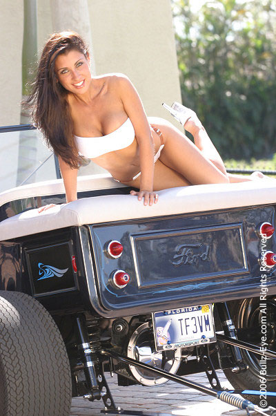 Jessica Canizales on a hot rod
