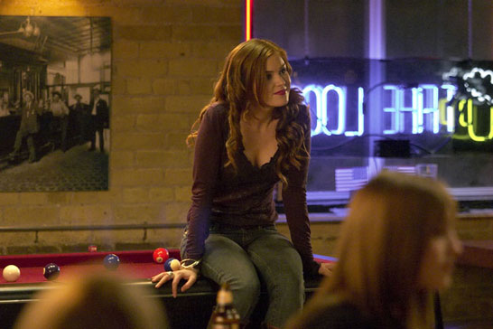 "Isla Fisher sitting on a pool table in ""The Lookout"""