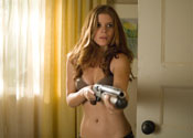 "Kate Mara holding a shotgun in ""Shooter"""