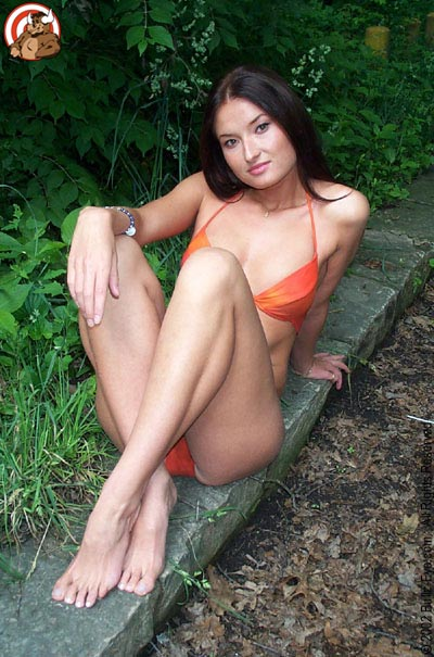 Kaya in orange bikini