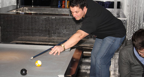 Tom Orlando playing pool
