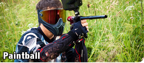 Young Man Hinding in the Brush During a Recreational Game of Paintball