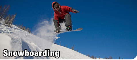 Young Man Snowboarding on a Mountain