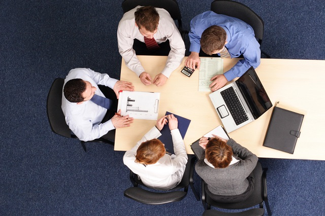 team of office workers around a table