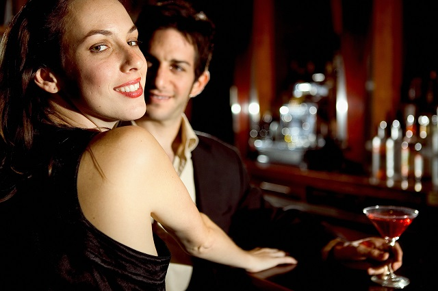 man and woman on a date in a bar