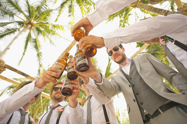 men in wedding party drinking beer