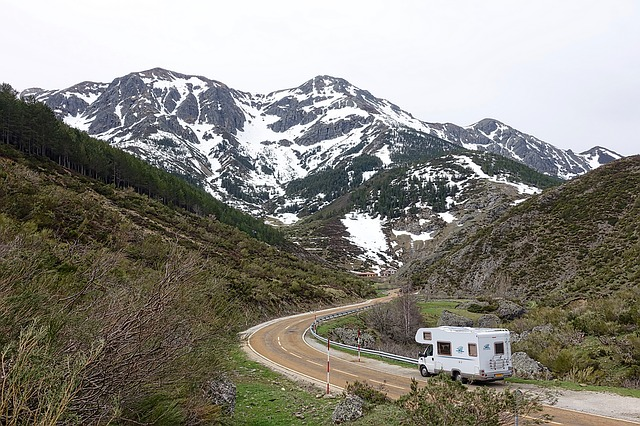 motorhome driving through mountains