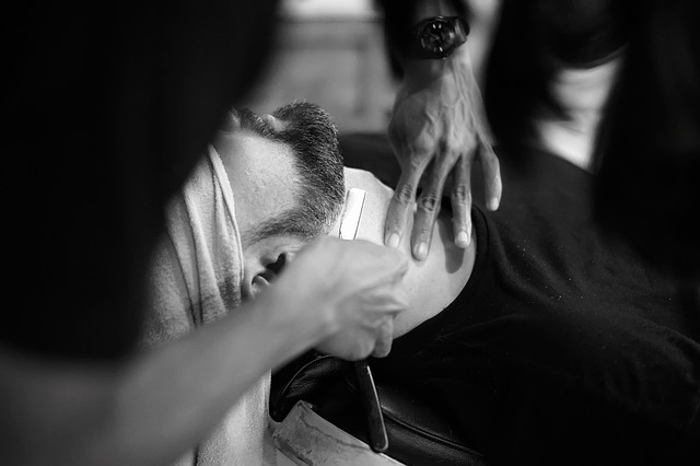 straight razor shave in barber chair
