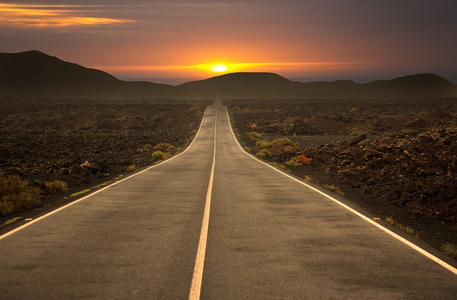 open road at sunset