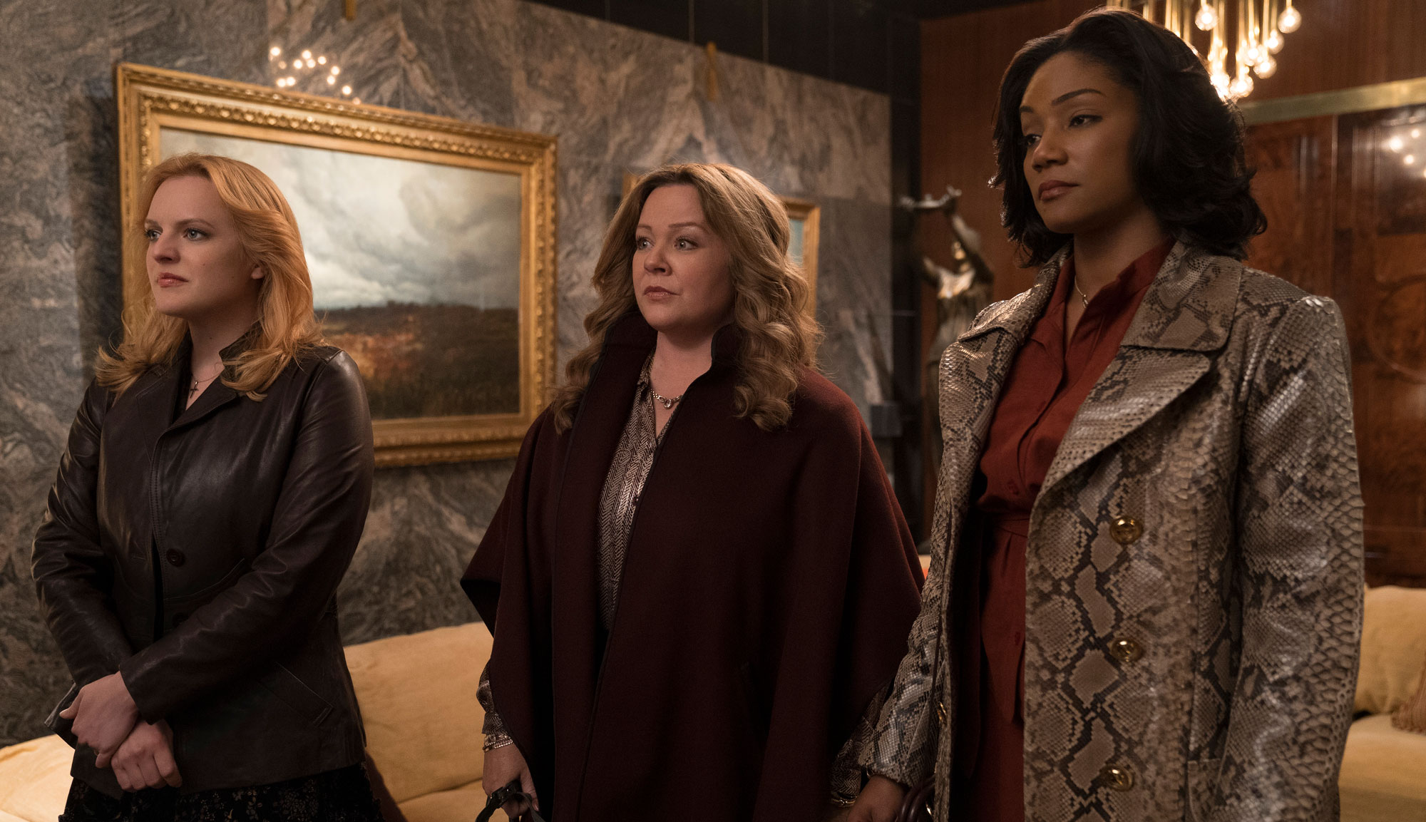 "Elisabeth Moss, Melissa McCarthy and Tiffany Haddish in ""The Kitchen"""