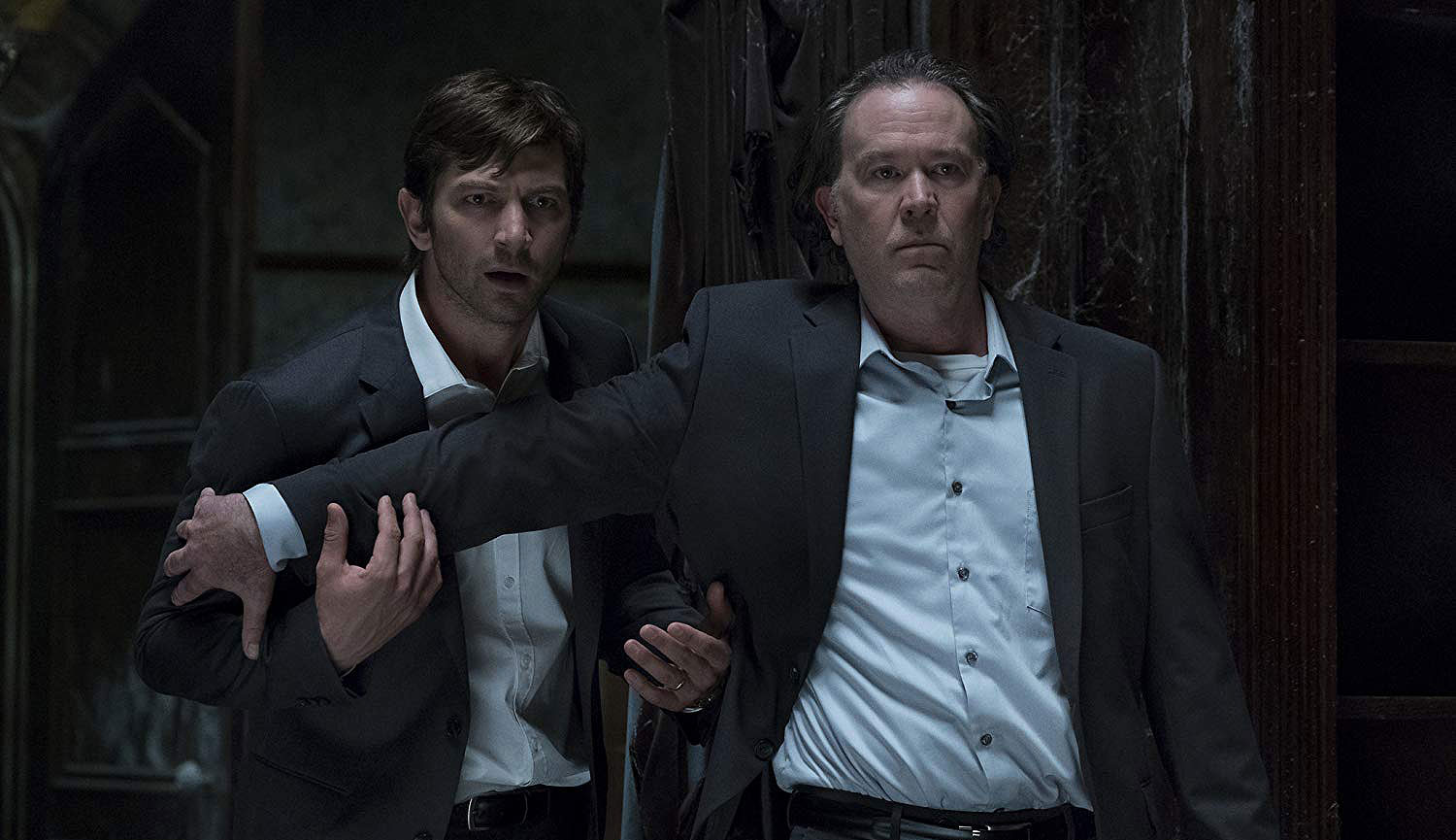 """Michiel Huisman and Timothy Hutton in """"The Haunting of Hill House"""""""