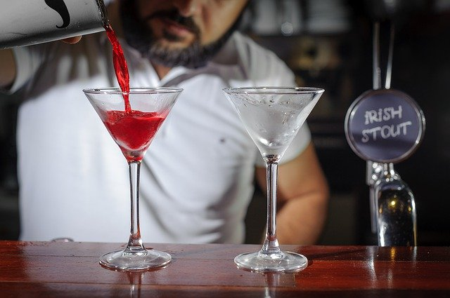 bartender pouring cosmo