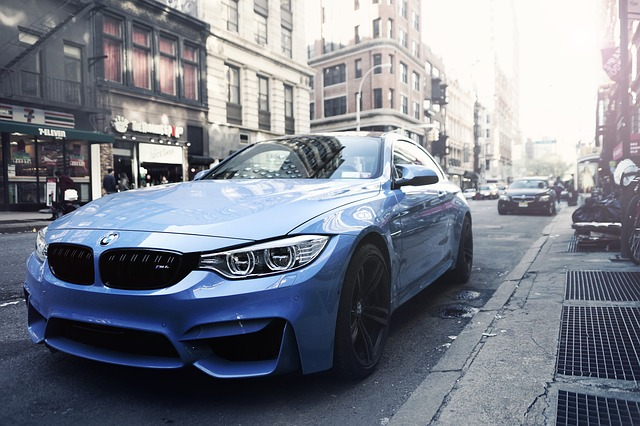 baby blue BMW in city street