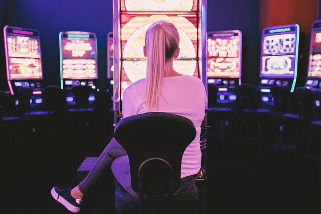 woman playing casino slot machines